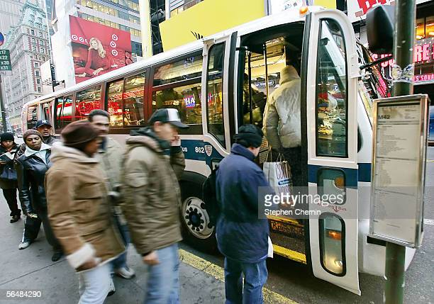 Commuters queue up for a New York City bus on 42nd street after the three day transit strike December 23 2005 in New York City New York's subways and...