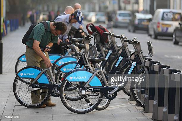 Commuters rent Barclays Cycle Hire bikes from a docking station on September 5 2013 in London England Since the scheme's launch in 2010 over 22...