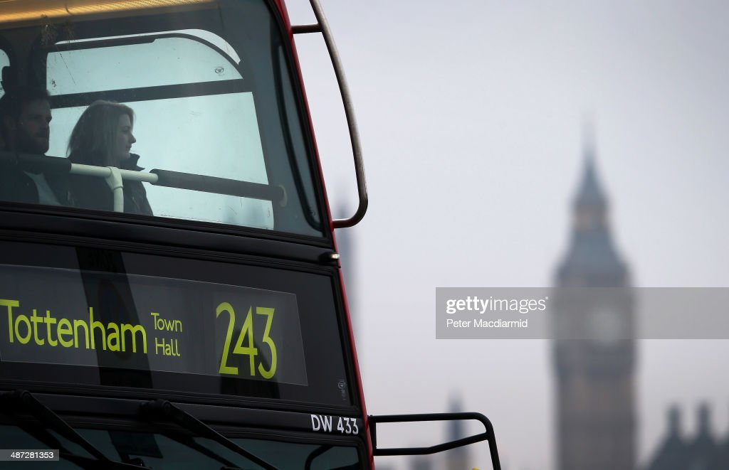 Commuters ride a bus on Waterloo Bridge in sight of Parliament on April 29, 2014 in London, England. Union members are striking for 48 hours in a dispute over management plans to close all ticket offices with a loss of nearly 1000 jobs.