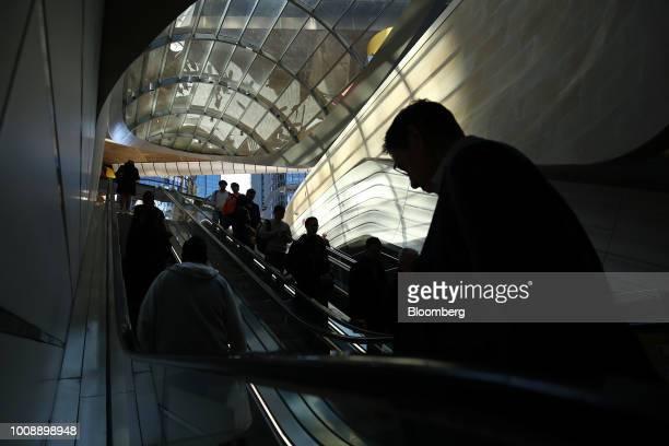 Commuters ride escalators as they go through the Wynyard Walk pedestrian tunnel at Wynyard railway station in Sydney Australia on Monday July 30 2018...
