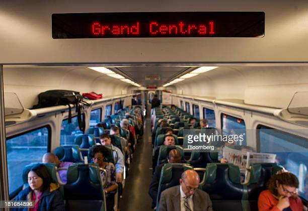 Commuters ride on a MetroNorth Railroad train towards Grand Central Terminal in New York US on Thursday Sept 19 2013 MetroNorth Railroad a subsidiary...
