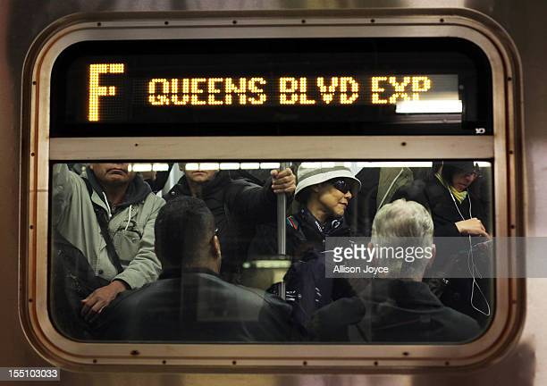 Commuters ride the F train November 1 2012 in New York City Limited public transit has returned to New York With the death toll continuing to rise...
