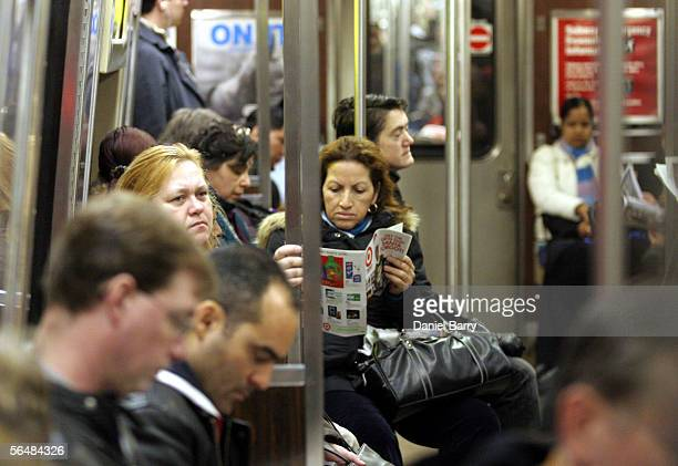 Commuters ride the subway December 23 2005 in New York City After three days of strikes New York City subways and buses returned to service bringing...