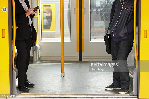 Commuters riding on a train wait to depart from Central Station in Sydney Australia on Tuesday June 9 2015 Australian wages fell in the first quarter...