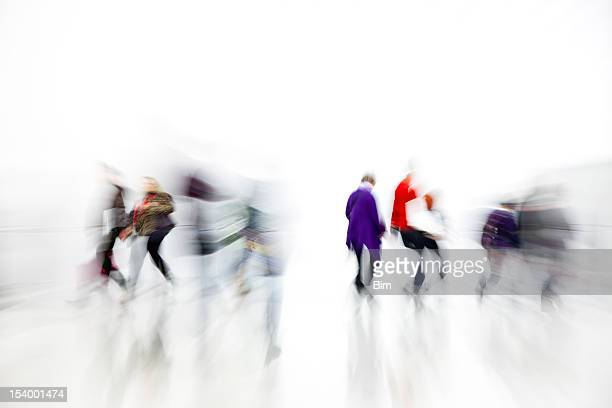 Commuters Rushing in White Interior, Blurred Motion, White Background