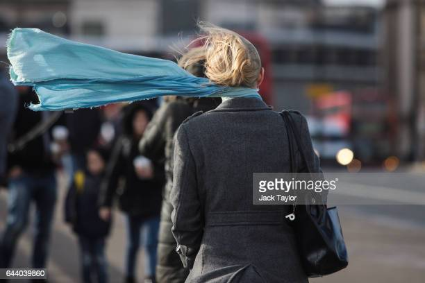 A commuter's scarf blows in the wind as they cross London Bridge on February 23 2017 in London England Flights have been cancelled and commuter...