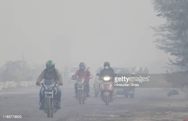 Commuters seen at Dwarka Expressway amid heavy smog, on November 21, 2019 in Gurugram, India. Air quality in many parts of Delhi and the National...
