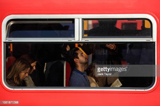 Commuters sit on a train as it passes through Clapham Junction Station during the morning rush hour on October 11 2018 in London England The Office...