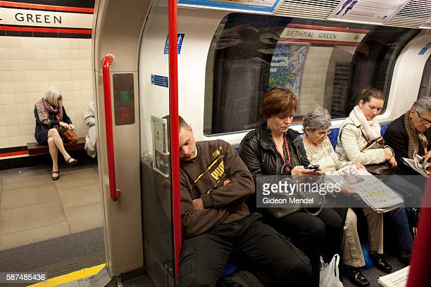 Commuters site in a carriage on the Central Line on the London Underground transport network This is the line heading towards Stratford Station which...