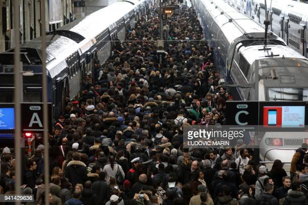 TOPSHOT Commuters stand on a crowded platform of the Gare de Lyon railway station on April 3 2018 in Paris on the first day of a two days strike...