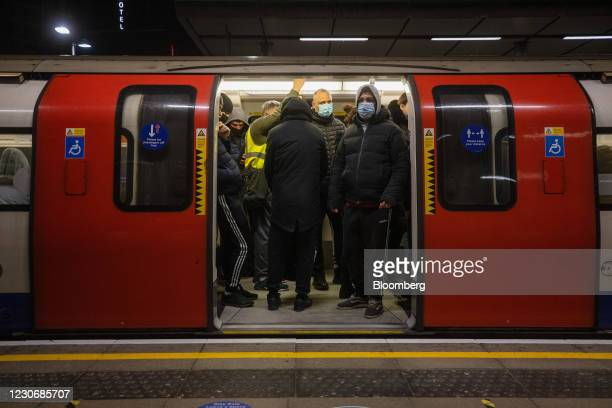 Commuters stand on a Jubilee line tube train at Canning Town Station in London, U.K., on Wednesday, Jan. 20, 2021. Data shows Britons are far more...