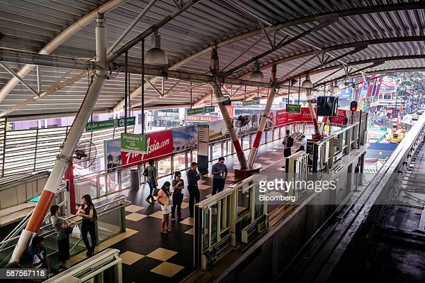 Commuters stand on the platform of Bukit Bintang station in Kuala Lumpur Malaysia on Friday Aug 5 2016 Malaysia's secondquarter gross domestic...