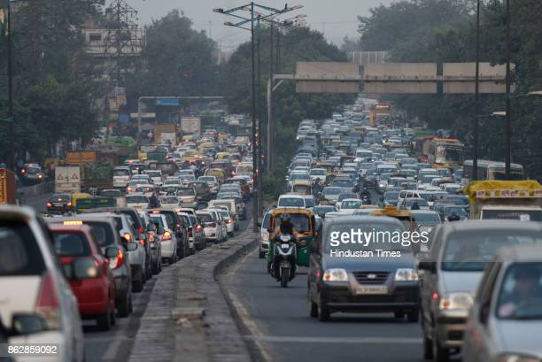 Commuters stuck in a massive traffic jam in the evening at Ashram flyover a day before Diwali on October 18 2017 in New Delhi India Traffic...