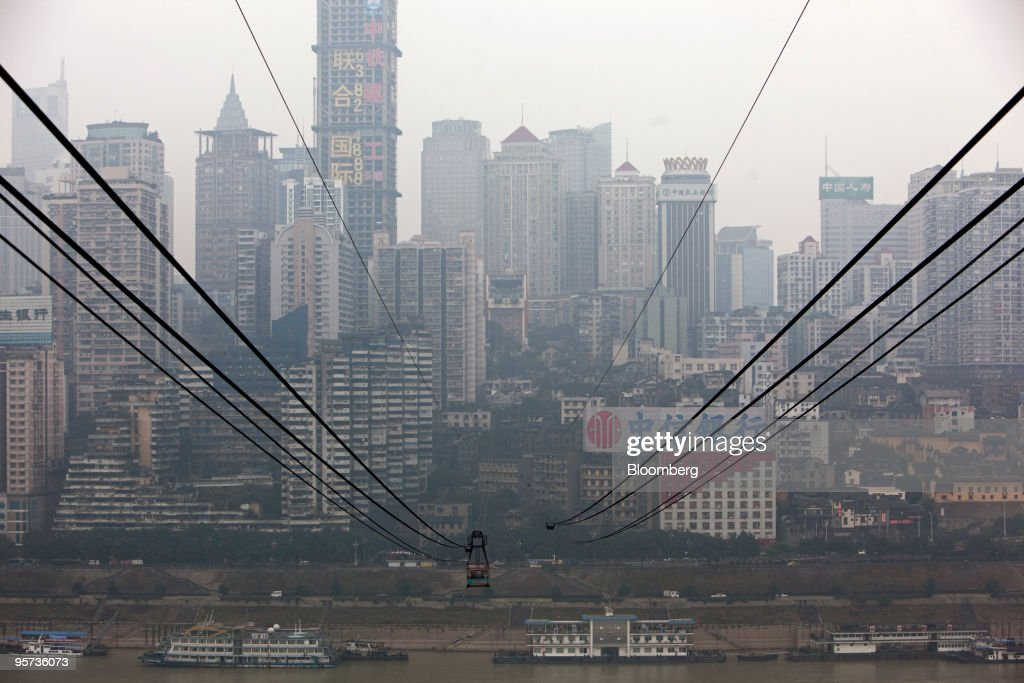 Commuters take a cable car across the Yangtze river in Chong : News Photo