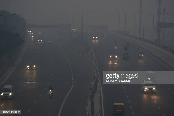Commuters travel amid heavy smog in New Delhi on November 8 2018 Air pollution in New Delhi hit hazardous levels on November 8 after a night of...