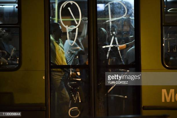 Commuters travel on a bus during a power outage in Caracas Venezuela on March 26 two weeks after a similar outage caused deaths and chaos Venezuela...