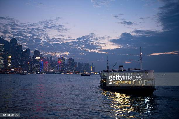 Commuters travel on the Star Ferry in Victoria Harbour from Kowloon to Hong Kong island on November 21 2013 Hong Kong's economy grew moderately...
