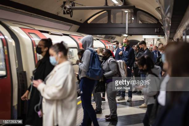 Commuters travel on the underground network during rush hour on July 06, 2021 in London, England. The UK government will no longer compel...