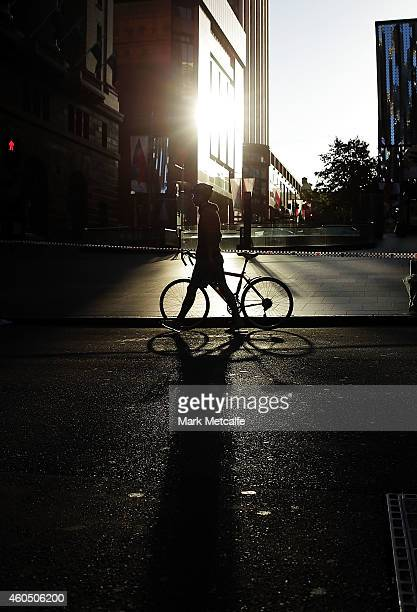 Commuters travel past police tape at Martin Place on their way to work on December 16 2014 in Sydney Australia The siege in Sydney's Lindt Cafe in...