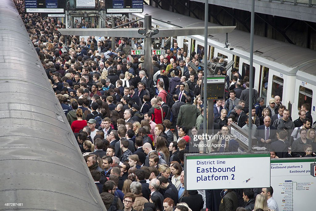 Commuters try to get on a train on the District Line of the London Underground during the 48-hour tube strike at London's Earl's Court tube station in England on April 29, 2014.