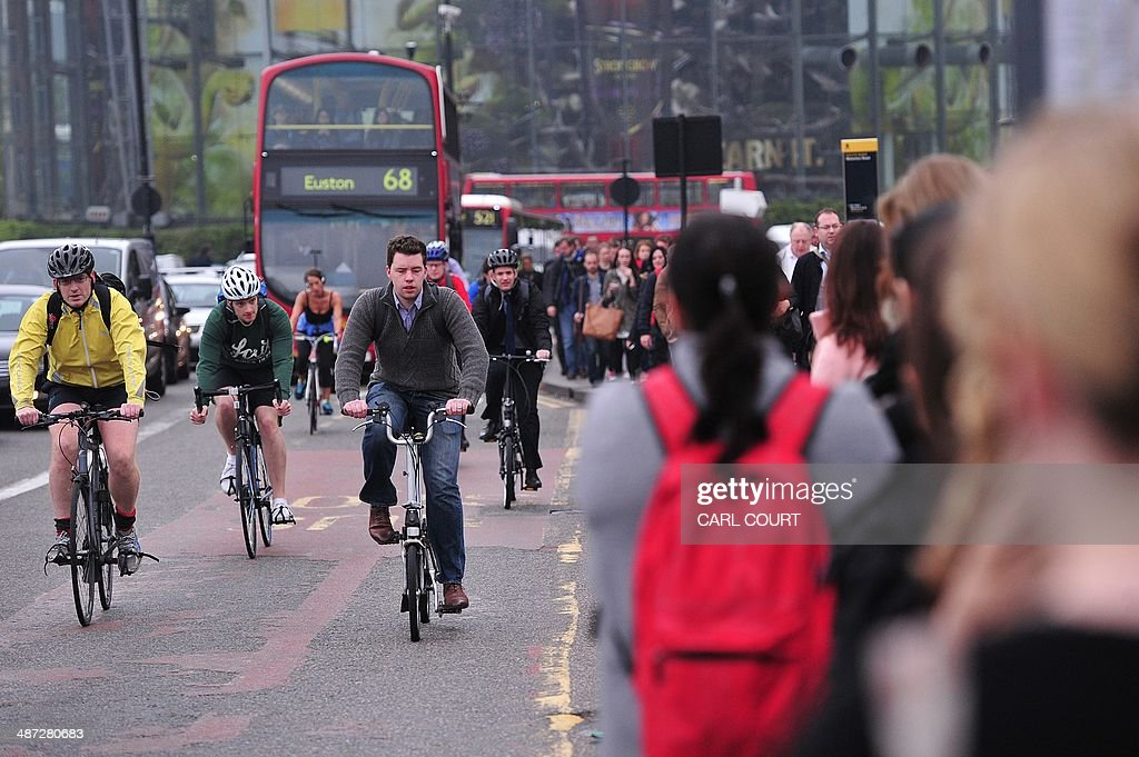 Commuters use bicycles to get to work as they cross Waterloo Bridge in London, on April 29, 2014, as a planned 48 hour underground train strike came into effect late Monday night. Workers on London's Underground train system began a 48-hour strike at 9:00 pm (2000 GMT) on Monday, threatening chaos for commuters and hitting football supporters attending Arsenal's match with Newcastle.