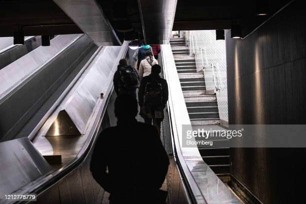 Commuters use escalators while exiting ChateletLesHalles metro station in Paris France on Tuesday May 12 2020 The Paris metro authority is testing...