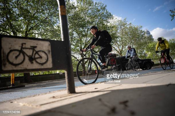 Commuters use the cycle lanes as they travel into London on May 11, 2020 in London, England. The prime minister announced the general contours of a...
