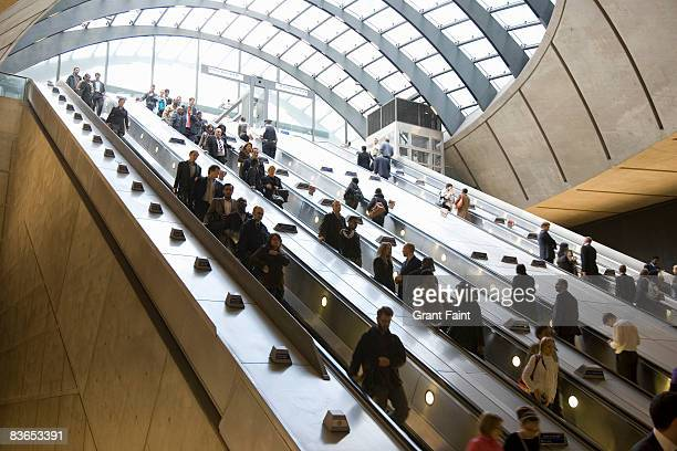 commuters using escalator getting to subway