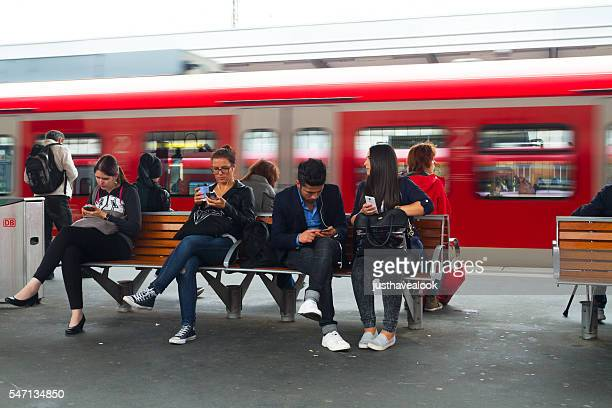Commuters using mobiles