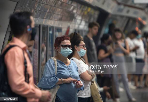 Commuters using the Bakerloo line at Oxford Circus mostly opt to wear face coverings on July 19, 2021 in London, United Kingdom. As of 12:01 on...