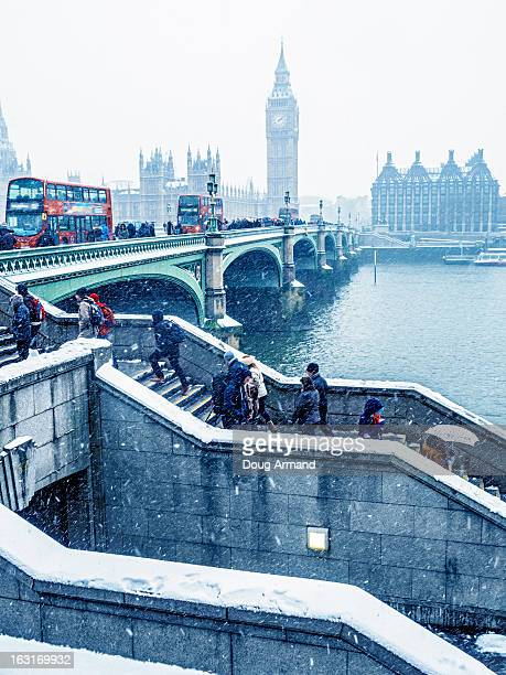 Commuters using Westminster Bridge in the snow