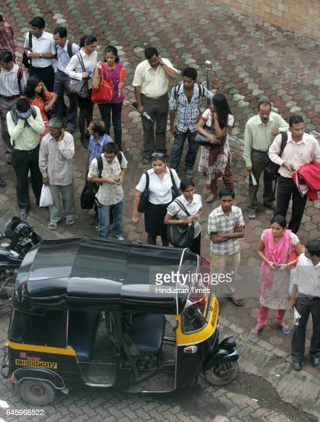 Commuters wait at a bus queue outside Andheri station because of flash strike called by Auto and Taxi men to protest the increase in the prices of...