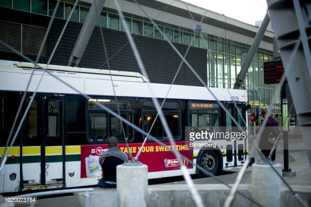 Commuters wait at a bus stop at the Rosa Parks Transit Terminal in Detroit Michigan US on Tuesday Aug 14 2018 Detroit ranks in the top 7 percent for...