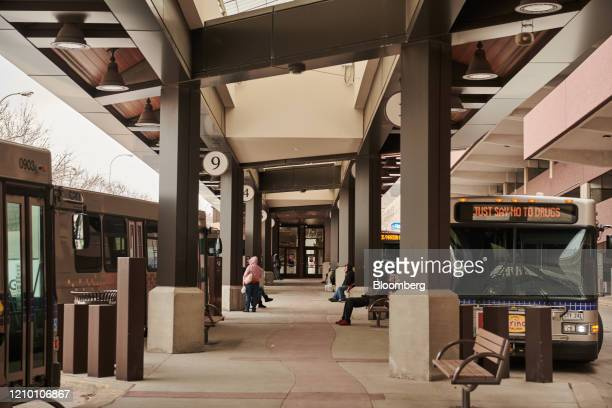 Commuters wait at a Sioux Area Metro bus station in downtown Sioux Falls South Dakota US on Wednesday April 15 2020 South Dakota Governor Kristi Noem...