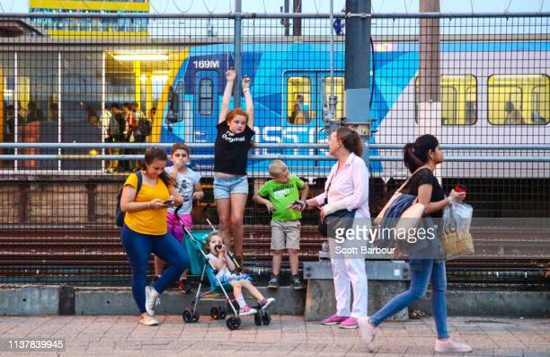Commuters wait for buses and trains at Glen Waverley station in the electoral division of Chisholm on April 17 2019 in Melbourne Australia The...