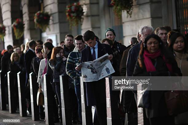 Commuters wait for taxis outside Waterloo station on February 5 in London England Today marks the first full day of a 48 hour strike by London...