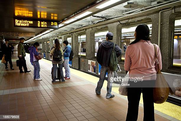 Commuters wait for the last Red Line T train at South Station on Monday October 29 2012 The MBTA commuter train in Boston Massachusetts was closed at...