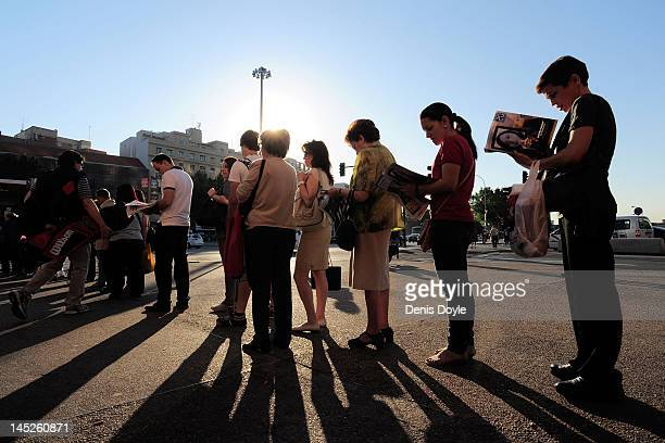 Commuters wait for their bus at Atocha train station on May 25 2012 in Madrid Spain Spain's ailing economy struggles to recover with the number of...