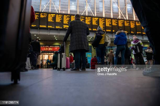 Commuters wait for trains at King's Cross train station on January 2 2020 in London England The fare increases which were announced in November...