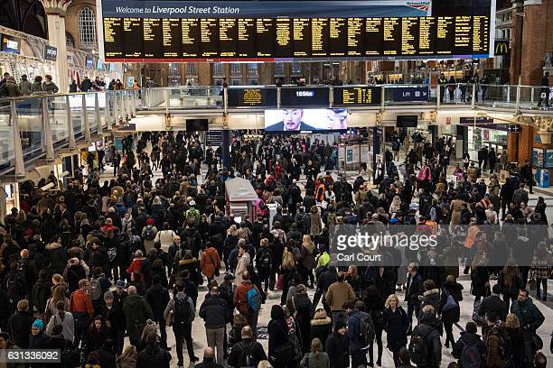 Commuters wait for trains at Liverpool Street Station on January 9 2017 in London England Millions of people are facing severe travel disruption...