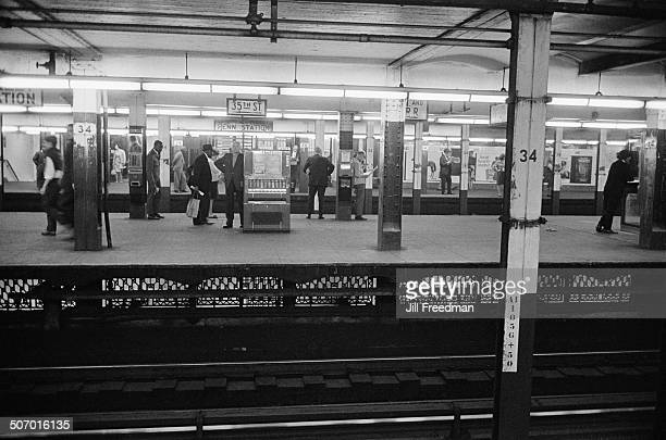 Commuters wait for trains at Pennsylvania Station New York City USA 1966