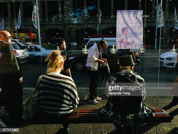 Commuters wait for transportation at the Eddy Avenue bus stop, opposite Central Station in Sydney, Australia.