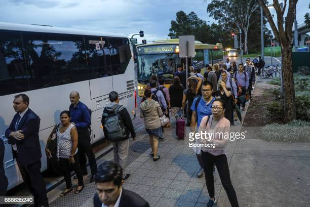 Commuters wait in line as a Hillsbus Co bus rear stops at the Riley TWay bus station in the suburb of Kellyville in Sydney Australia on Thursday...