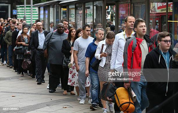 Commuters wait in line for buses near Waterloo station on August 6 2015 in London England London Underground workers are staging another 24 hour...