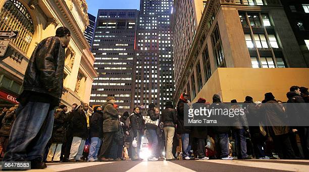 Commuters wait in line to board trains outside Grand Central Terminal during the evening rushhour December 21 2005 in New York City Toussaint offered...