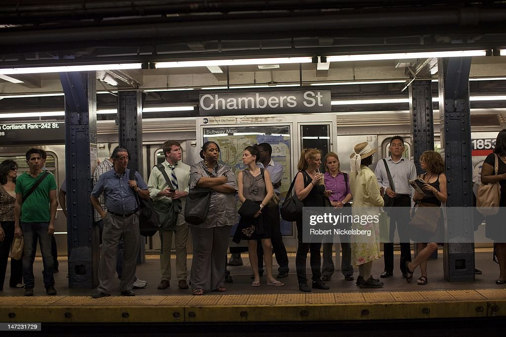 Commuters wait on a subway platform June 20, 2012 in New York City.