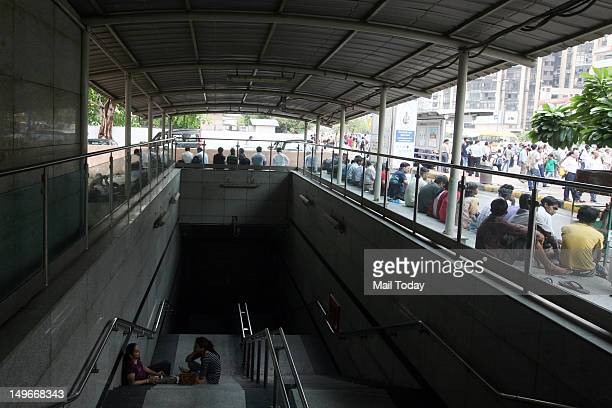 Commuters wait outside a Metro station after Delhi Metro rail services were disrupted following power outage in New Delhi India Tuesday July 31 2012...