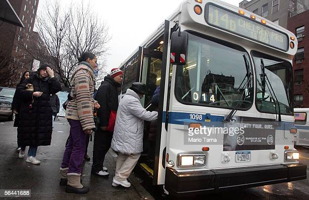 Commuters wait to board a Metropolitan Transit Authority bus on 14th Street during the morning rushhour December 16 2005 in New York City Transit...