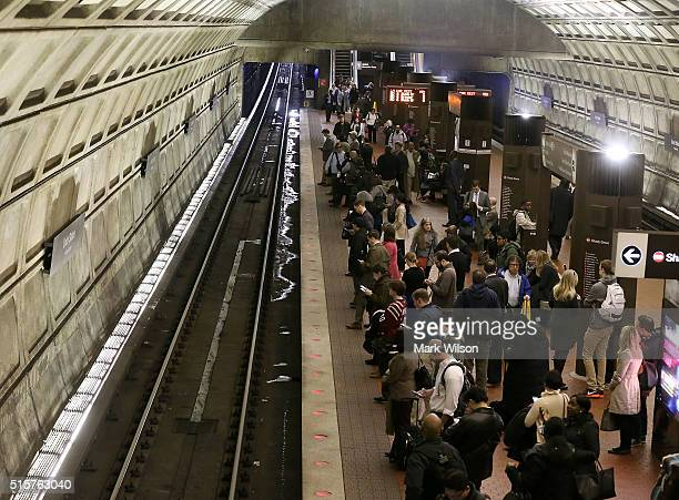 Commuters wait to board a Metrorail train at Union Station, March 15, 2016 in Washington, DC. Metrorail announced today that they will shut down...