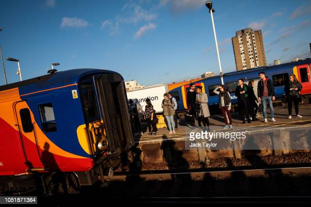 Commuters wait to board a train at Clapham Junction Station during the morning rush hour on October 11 2018 in London England The Office of Road and...